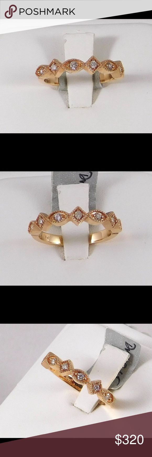 14k Rose Gold Stackable Ring Super cute stackable 14k rose gold ring. Also available in yellow and white gold. With 0.15 carats of G/SI1 diamonds. The gold is cut into marquis and diamond shapes with filigree detailing. Looks amazing when stacked with the yellow and white gold. Get all three Jewelry Rings