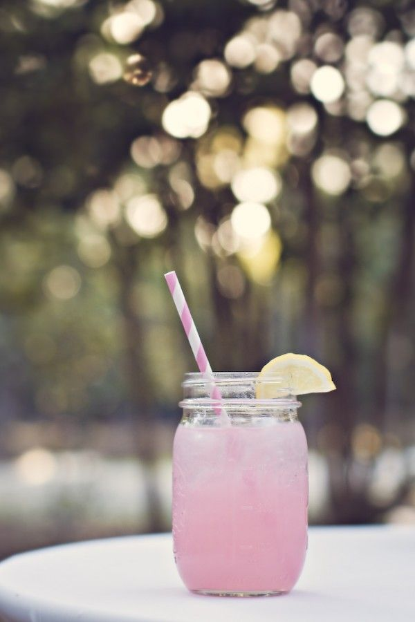 create a signature cocktail: spiked pink lemonade with striped straw