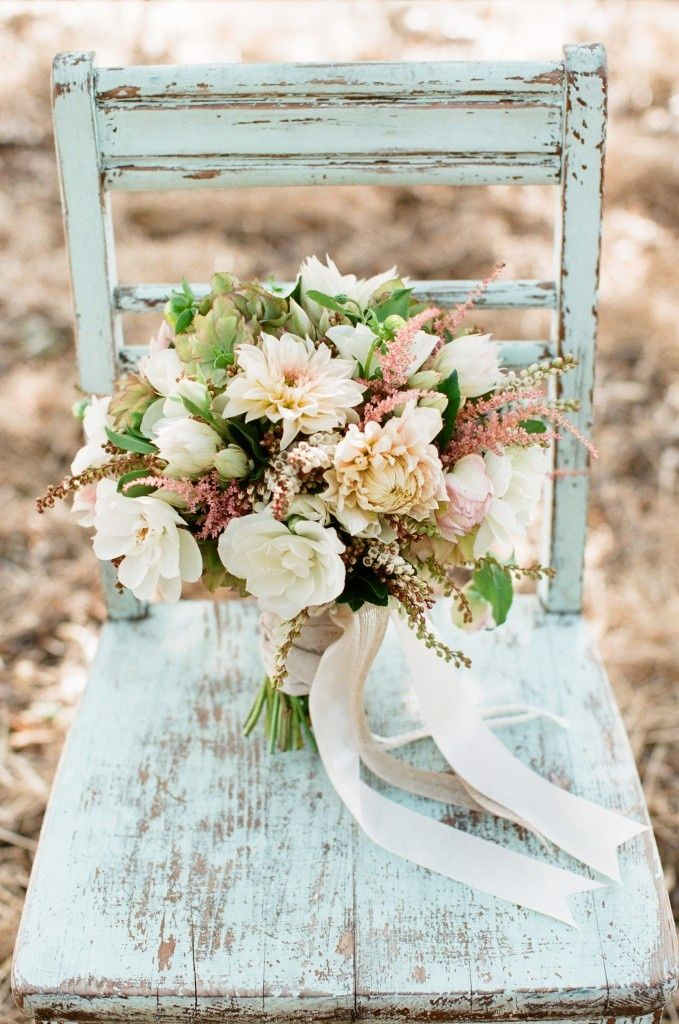 rustic old seafoam green chair and light bouquet