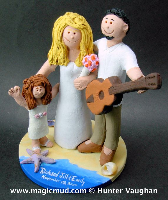 Wedding Cake Topper with Daughter    Wedding Cake Topper for an Acoustic Guitar Player, custom created for you! Perfect for the marriage of a Guitar Playing Groom and his Bride!    $235   #magicmud   1 800 231 9814   www.magicmud.com