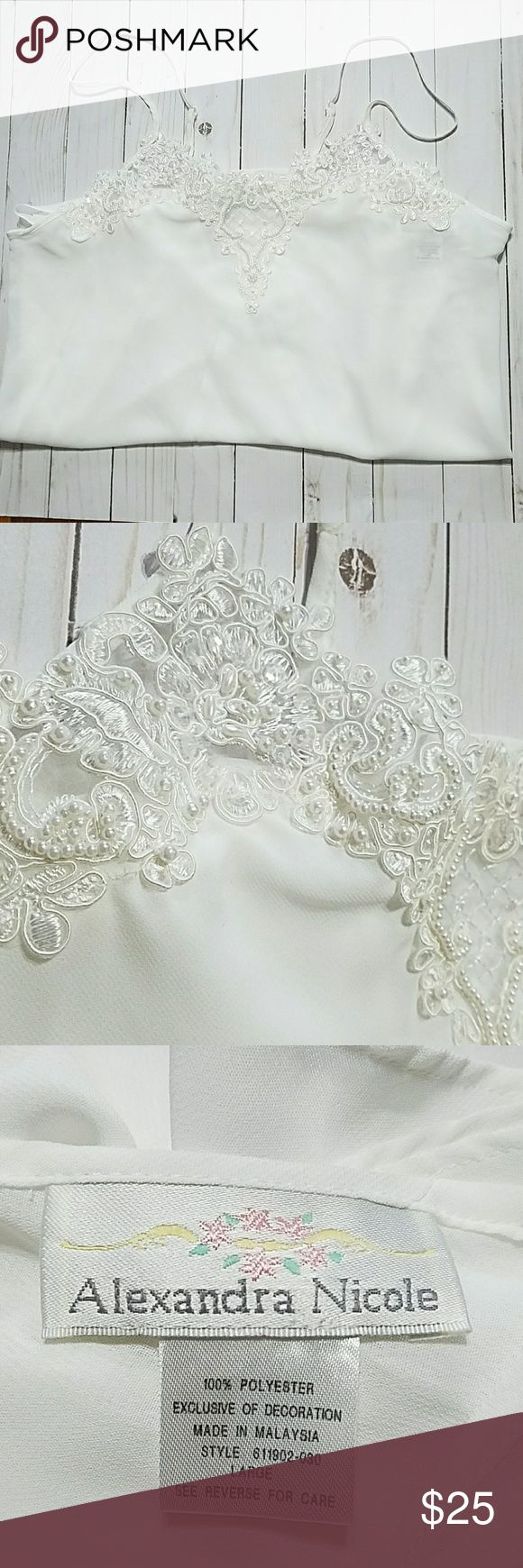 Alexandra Nicole Ivory Bridal Chemise L NWOT Alexandra Nicole New no tags  Women's chemise  Ivory  Adjustable straps Front yoke embellished lace w/crystal sequins & pearls Decorated back bow  Size large Pit to pit 22 Length 32 100% polyester  Made in Malaysia Alexandra Nicole Intimates & Sleepwear Chemises & Slips