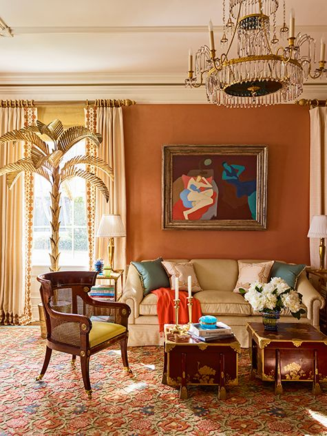 In the living room of an oceanfront home in Palm Beach, Cullman & Kravis placed a metal palm-tree sculpture from the 1940s in front of a window and turned a pair of Japanese Meiji-period gold and lacquer robe boxes on gilt-copper mounts into coffee tables.