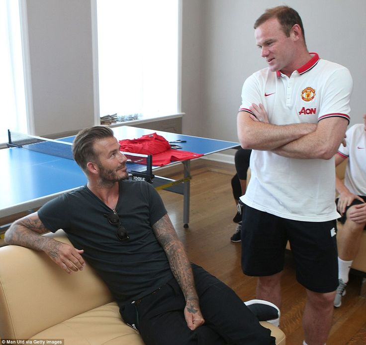 Old mates: Rooney (right) speaks with United legend David Beckham, who also made an indeli...