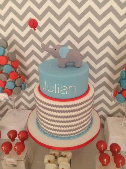 An Elephant and Balloon Cake: How sweet is this awesome, elephant-topped first birthday cake that featured the partys big themes — elephants, chevron, and balloons!  Source: Oh So Chic Celebrations
