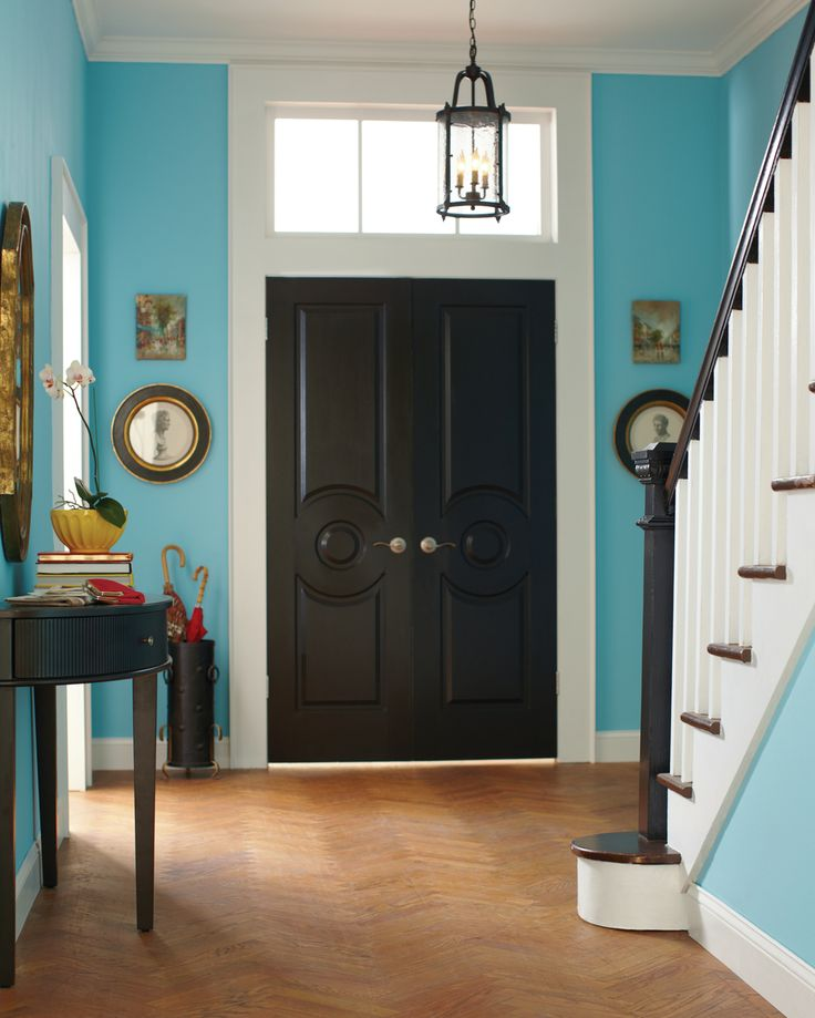 Behr's Sky Watch paint is what gives this entryway its cheery, but elegant look.