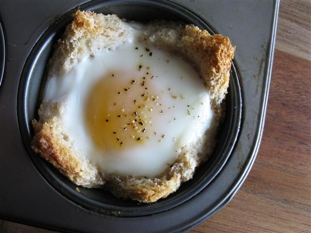 Baked Eggs in a Basket:   2 pieces of bread, 2 eggs, well buttered muffin tin, salt and pepper, herb garnish.    Butter muffin tray, bake 375 for 14-18 mins.