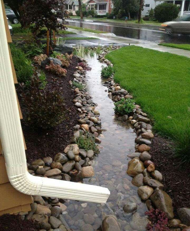 "Clever drainpipe into landscaped ""river"""