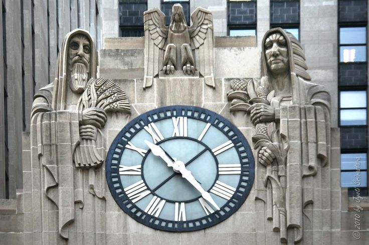 13 foot diameter clock on the Chicago Board of Trade building. The clock faces LaSalle Street and is flanked by statues of two hooded figures, one holding corn and one holding wheat.