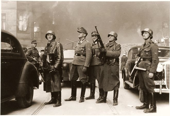 """""""One of the most publicized photos of the suppression of the Warsaw ghetto uprising: German SS Police General Jürgen Stroop during the Uprising, Apr-May 1943; note policeman near him with MP 40 submachine gun. Stroop was hanged for his war crimes after the end of hostilities."""""""