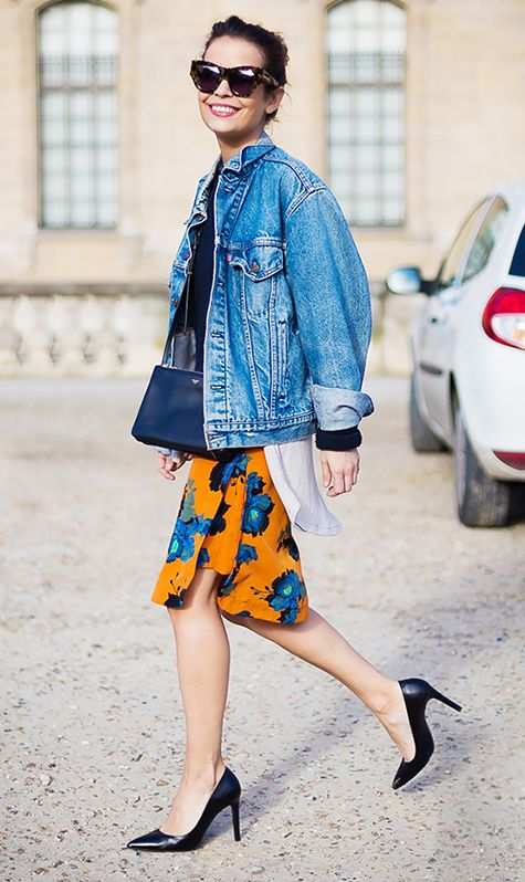 Colorful floral skirt with black leather pumps and an oversized denim jacket