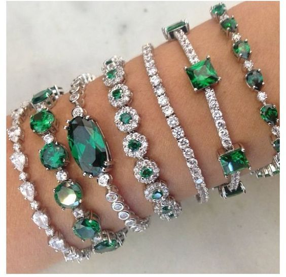 Emeralds   diamonds. I don't normally love emeralds, butthese bracelets would make anyone reconsider. So…