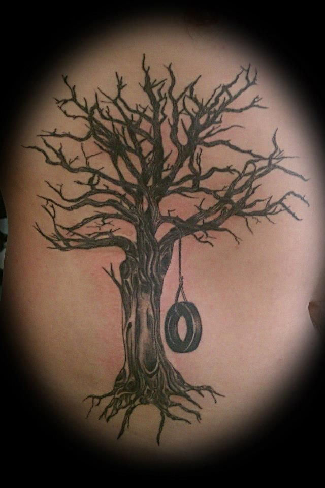 Realistic old dead tree with a tire swing