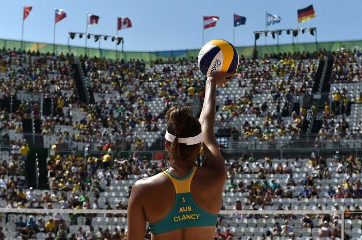 Australia's Taliqua Clancy prepares to serve the ball during the women's beach volleyball qualifying match between Australia and…