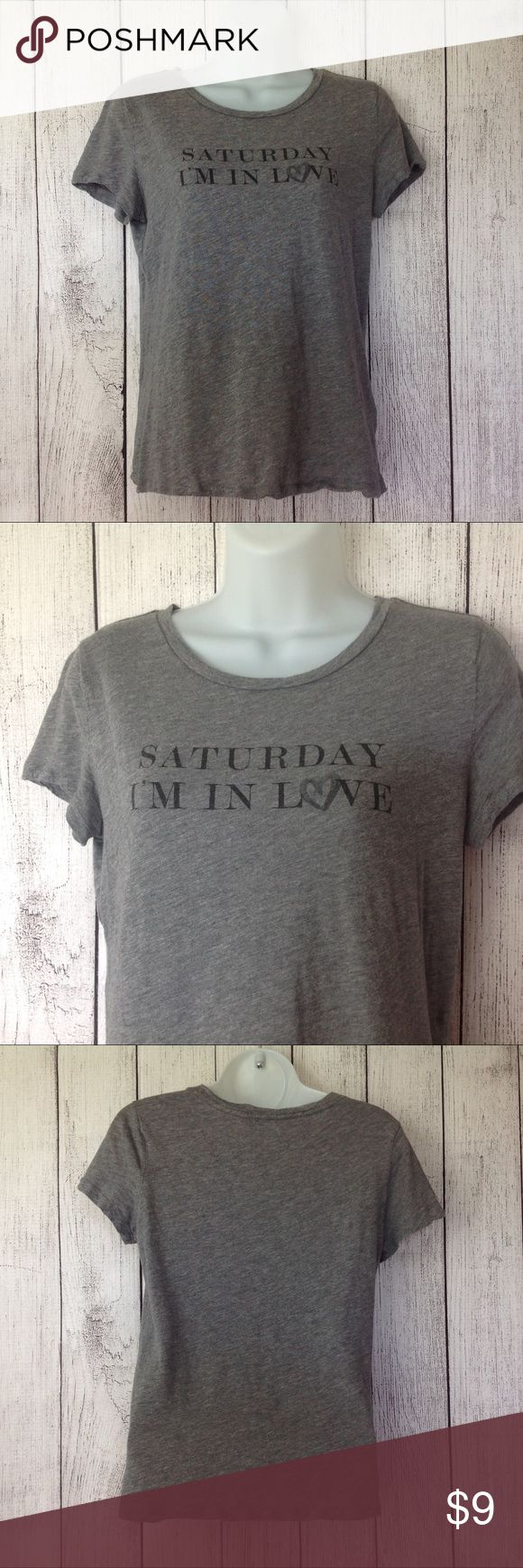 """Saturday Im In Love Tee Shirt Maker: Banana Republic ♥ Material: 60% Cotton 40% Modal ♥ Color: Gray ♥ Measured Size: Pit to pit- 18"""" Pit to cuff- n.a Shoulder to waist- 22""""  ♥ Tag Size:  XS ♥ PLEASE CHECK YOUR ACTUAL MEASUREMENTS TO MAKE SURE IT IS THE RIGHT SIZE! THANKS!  ♥ Condition: Great Used Condition  ♥ Item #: (office use only) B  Follow us for coupon codes!  INSTAGRAM-thehausofvintage1984 Twitter- @hov1984 Facebook- Intergalactic Haus of Vintage 1984 Banana Republic Tops Tees - Short…"""