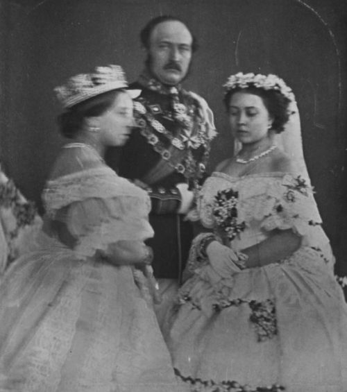 Queen Victoria, Prince Albert, and Vicky Princess Royal, on Vicky's wedding day, 25 January 1858. Queen Victoria, on the left, seemed to have been moving slightly and speaking during the shoot. Vicky was the first child of Victoria and Albert to be...