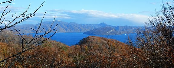 Lake Towada: Lake Towada is part of the Towada-Hachimantai National Park and is the largest caldera lake on Honshu, Japan's main island. Located on the border between Akita and Aomori Prefectures, the area is well known for its autumn colors especially around the Oirase Stream, one of Japan's most famous autumn color spots. - Towada Travel Guide