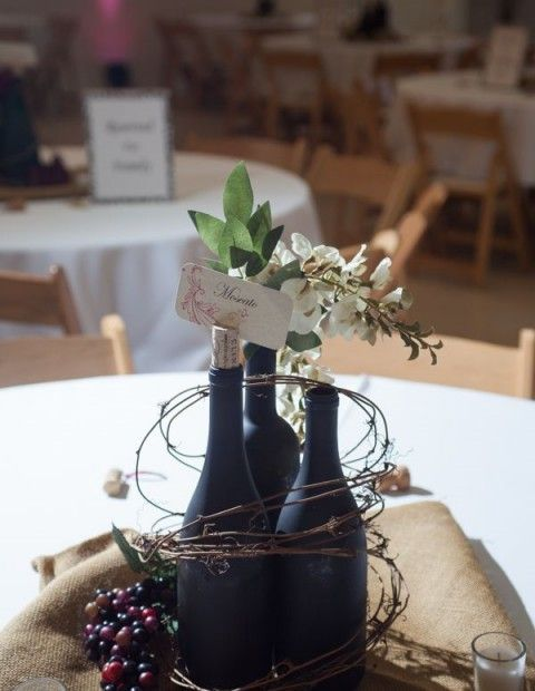 "Wonderful Centerpiece idea! Alternate Navy and Silver/Gray painted bottles (table # on one of bottles? ""S"" on another?)"
