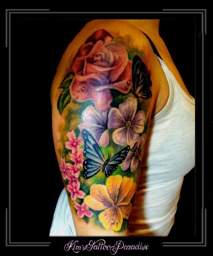 Tattoo | Kim's Tattoo Paradise vlinders bloemen bovenarm