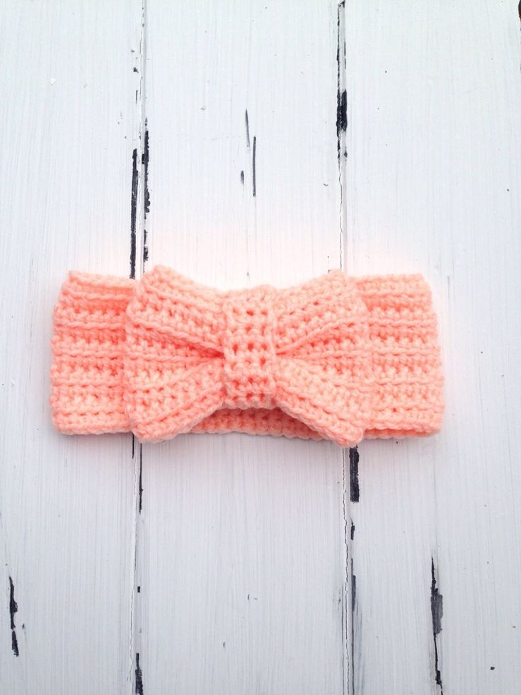 Handmade+crochet+bow+ear+warmer    Bow+measures+4+inches+wide.    Made+using+a+soft+acrylic+yarn.    Available+in+sizes+newborn+to+5+years