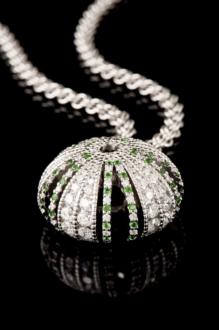 'Kina' pendant. This piece is fully handmade in 18ct white gold and is set with over 7cts of diamond. This truly is a delicacy and a treasure.