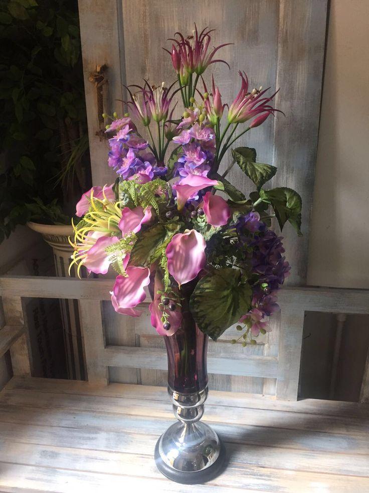 Callas, delphiniums in lilic.