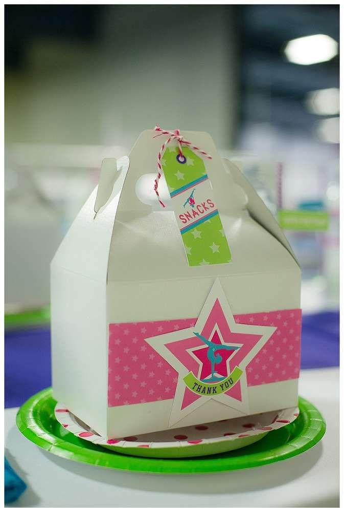 Favor boxes at a gymnastics birthday party! See more party ideas at CatchMyParty.com!