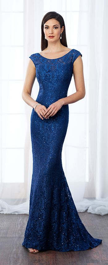 Lace fit and flare gown with scattered hand-beading features cap sleeves, illusion bateau neckline over sweetheart bodice, low square back, sweep train. Matching shawl included.