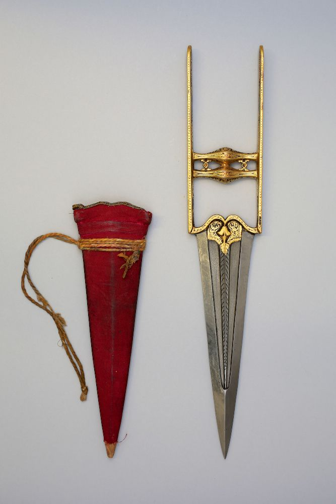 Indian katar, 19th century wootz steel with scabbard.