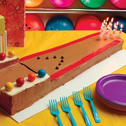 Bowling Lane Cake - I love the pin candles.  This site http://familyfun.go.com/recipes/dessert-recipes/cake-recipes/theme-cakes-general/ has tons of cake inspirations.