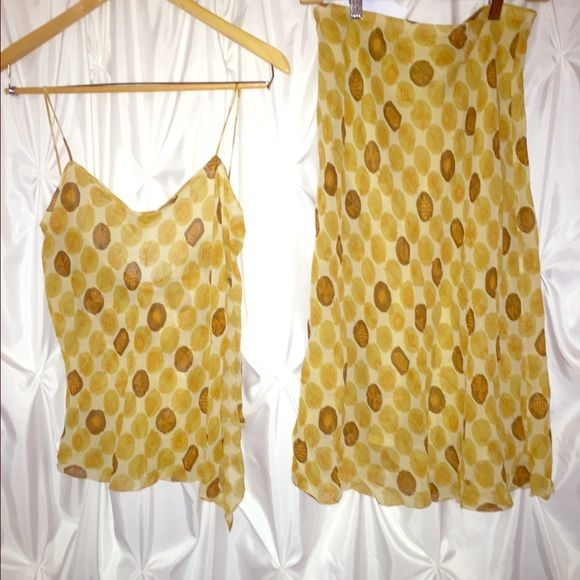 Max studio skirt and matching blouse Adorable yellow, brown , and orange print... Ruffle detail on top size lg.... Elastic waist skirt size med Max Studio Dresses
