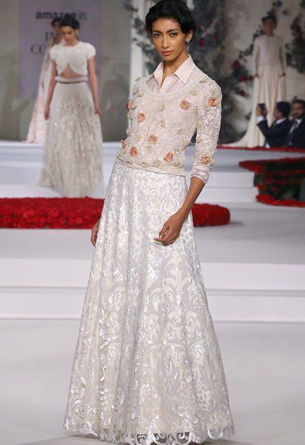 Ivory sequinned lehenga with floral embroidered shirt and blouse