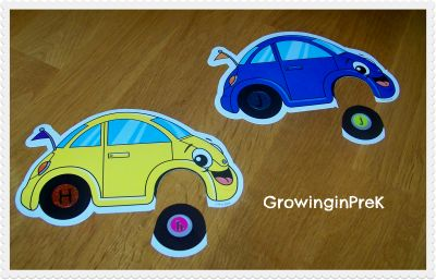 New ABC Centers- car cutouts, add alphabet stickers to the wheels, and cut off one wheel. The kids put the correct lowercase wheel on the car with the corresponding uppercase wheel.