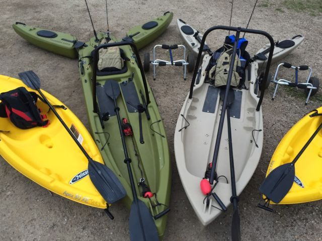 two freedom hawk kayaks for sale or trade for landscape services. includes life jackets, anchors, carts, and paddles. ready for the lake. little ones are already gone.
