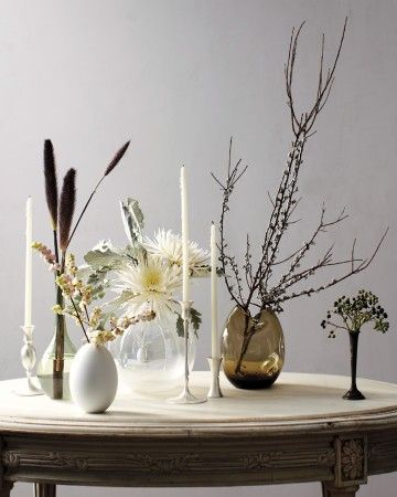 Black-and-White Arrangement - In late fall, nature's shapes become stark and geometric. Highlight plants that may be overlooked outdoors by placing a few stems of one or two types in their own eclectic vases.