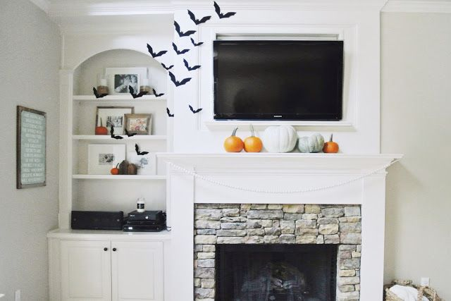built in shelving and fire place