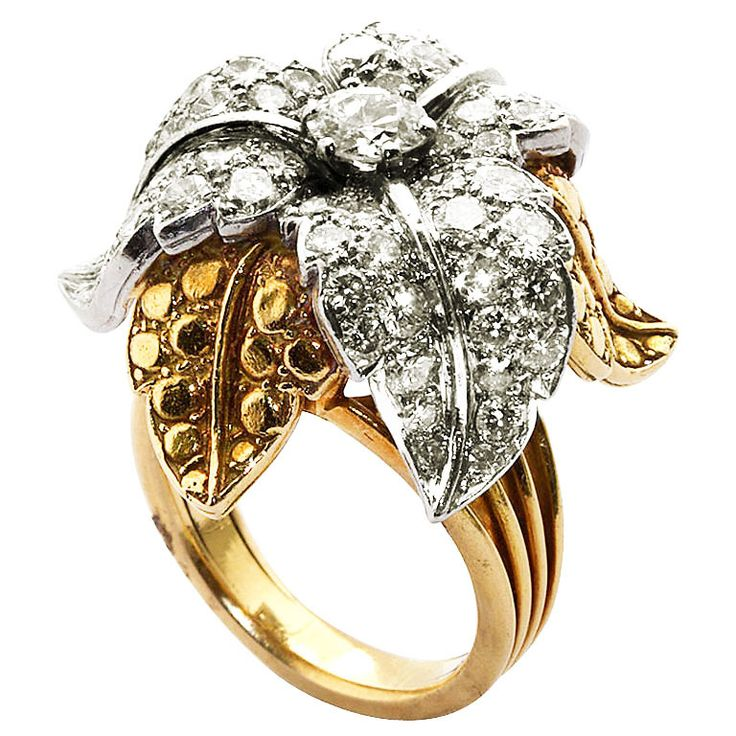 Diamond and gold acanthus ring   From a unique collection of vintage fashion rings at