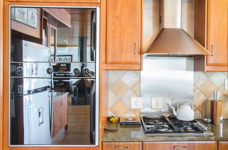 Built-in eye-level oven with hob and extractor fan in this kitchen.