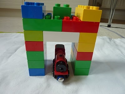 Constructing Tunnel for Wodden Train with big legos they don't play with anymore