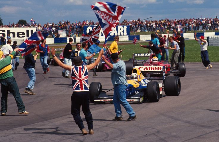 Nigel Mansell winning the 1992 British GP at Silverstone in the FW14B