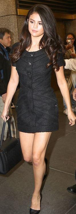 Who made Selena Gomez's black short sleeve tweed dress, pumps, and handbag?