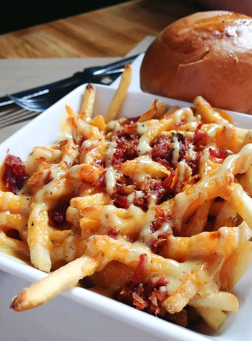 Cheese Fries with Bacon. Obviously the name says it all.  Granted, the pic looks better.  Just means you have to work a little harder. http://www.food.com/recipe/bacon-cheese-fries-201846