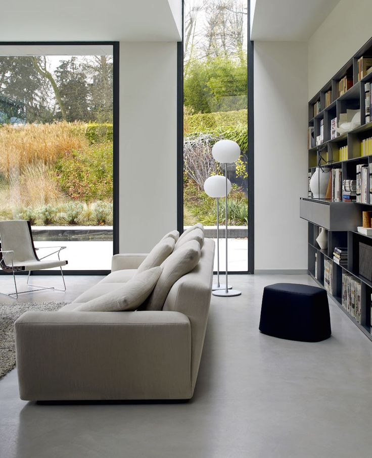 Contemporary Living Area With Large Windows, Tons Of Shelves