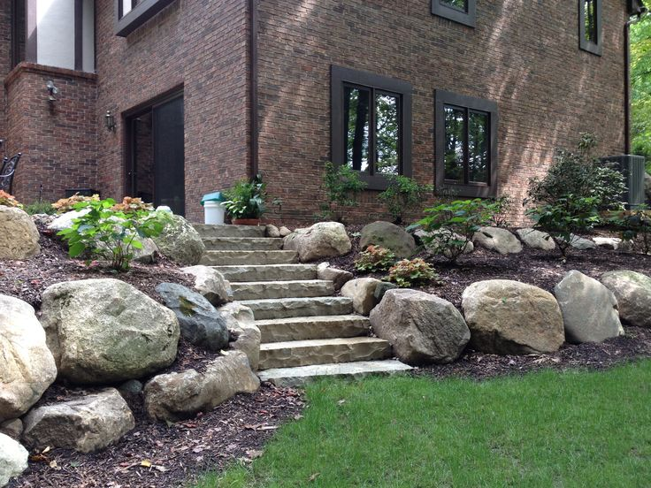 Boulder Retaining Wall and Limestone Steps for Naturalized Landscape