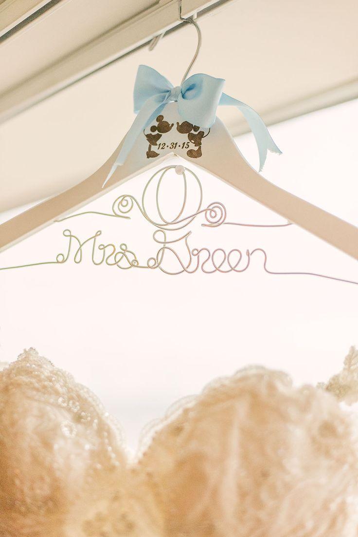 Disney Cinderella-inspired wedding details. Carriage monogram hanger.