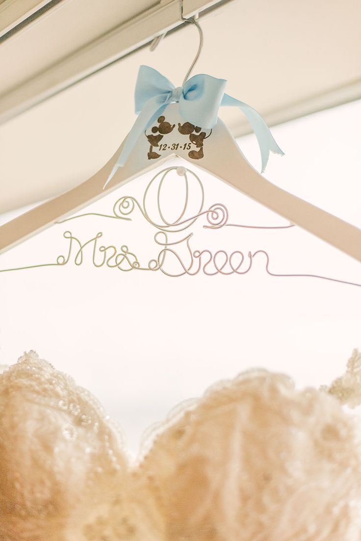 Disney Cinderella-inspired wedding details. Carriage monogram hanger.