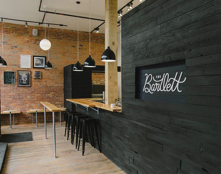 the bartlett cafe interior with black washed wood with exposed brick and industrial fixtures - Painted Wood Cafe Decoration