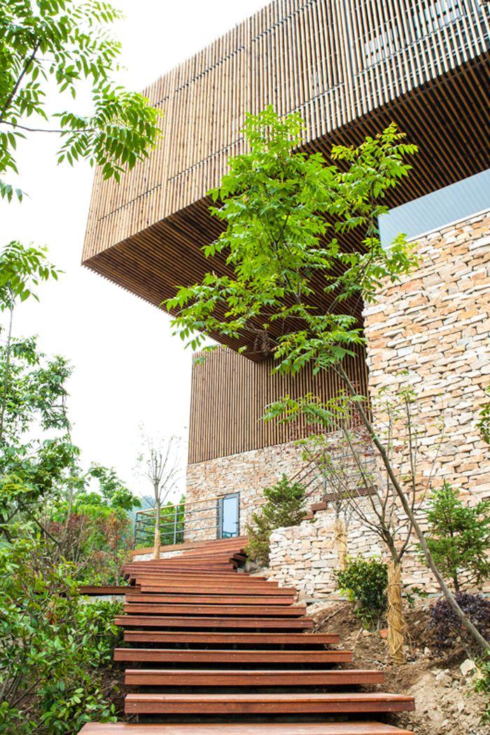 Overhang att Spa-Clubhouse, Garden Valley - Mei Jie Mountain Hotspring resort in Liyang, China. by AchterboschZantman architecten #walkway #slats #wood #overhang #bamboo #forest #shutters www.meijieresort.com