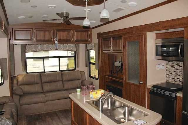 2016 New Forest River Blue Ridge 3780LF Fifth Wheel in North Carolina NC.Recreational Vehicle, rv, 2016 Forest River Blue Ridge 3780LF, This Blue Ridge FW by Forest River features quad slides for plenty of space to enjoy, a rear living layout, and two bedrooms, plus a loft above one!Step inside and head to the right up a couple of steps to a complete bath and front master bedroom. The bath offers a shower, toilet, and vanity with sink, plus overhead cabinets for storage. A sliding door…