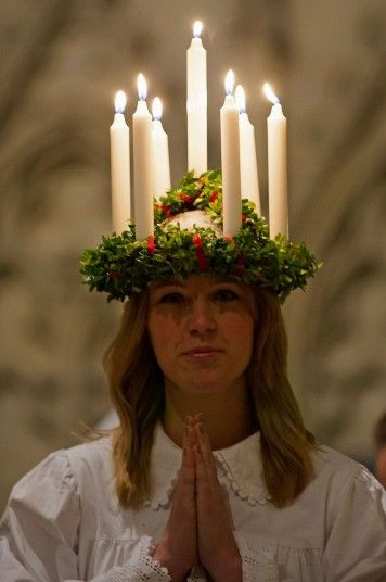 Sara Ringkrans, 28, a primary school teacher from York who moved to the UK from Stockholm, Sweden, prepares to lead off the procession at the start of the Sankta Lucia festival of light service at York Minster.