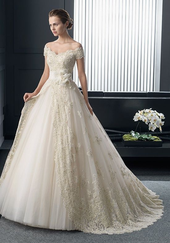 Two by Rosa Clará. Make it a Queen Anne neckline and this is my dream dress. :)